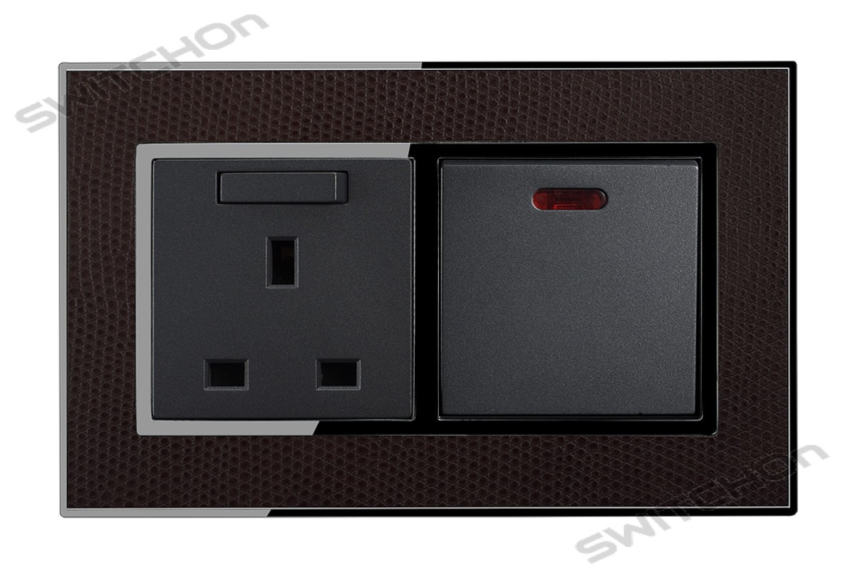 20 amp Appliance Switch with Neon Light with 13amp Socket finished in Real Leather